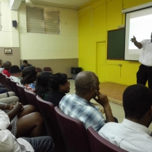 Prof. Taylor speaking to staff members of the Faculty of Science and Technology