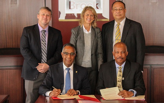 Professor Sir Hilary Beckles, Vice-Chancellor of The UWI (front right) and Gerva