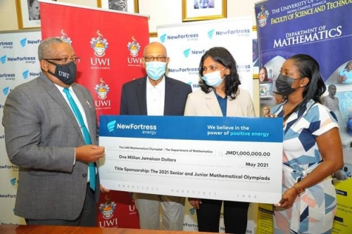 Prof. Dale Webber receives cheque valued at J$1 million from Jacqueline Burrell-Clarke